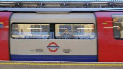 London, United Kingdom (UK) - 11 13 2018: London Underground Train Passing Station Slow Motion