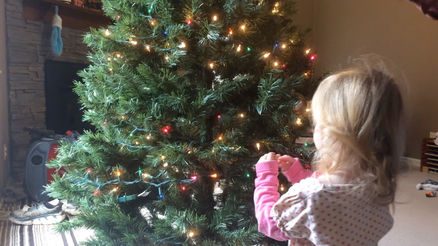 Mother and daughter decorating Christmas tree together   Shutterstock HD Video #1031975981