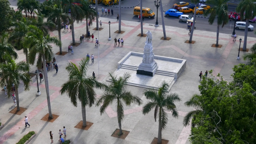AERIAL: People walking on Parque Central with the statue of José Martí, a Cuban National Hero and important figure in Latin American literature. | Shutterstock HD Video #1031999891