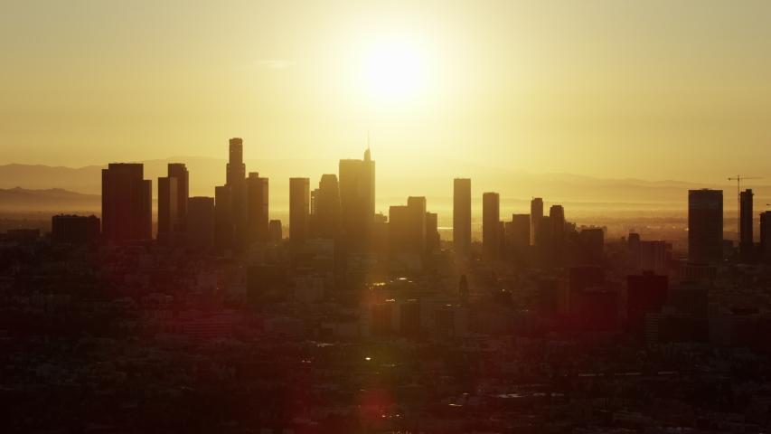 Aerial view at sunrise sun flare through residential and commercial skyscrapers downtown LA US Bank Tower California USA | Shutterstock HD Video #1032005711