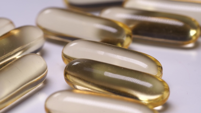 Close-up Macro Shot Of Yellow Gelatin Pills Rotating Slowly. Concept Of Health Promotion And Medical Treatment. Vitamins Tablets And Pharmaceuticals | Shutterstock HD Video #1032058001
