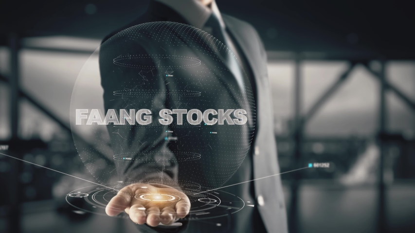 FAANG Stocks with hologram businessman concept | Shutterstock HD Video #1032213761