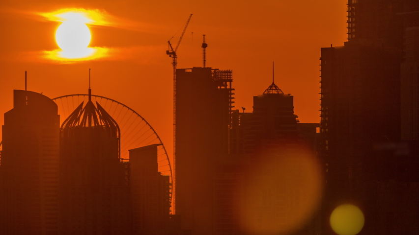 Dubai Marina skyscrapers from golf course sunset timelapse, Dubai, United Arab Emirates. Aerial view from Greens district. Close up view and orange sky | Shutterstock HD Video #1032292061