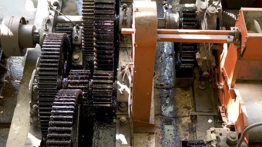 Large old gears turning slowly in the vintage machinery | Shutterstock HD Video #1032344051