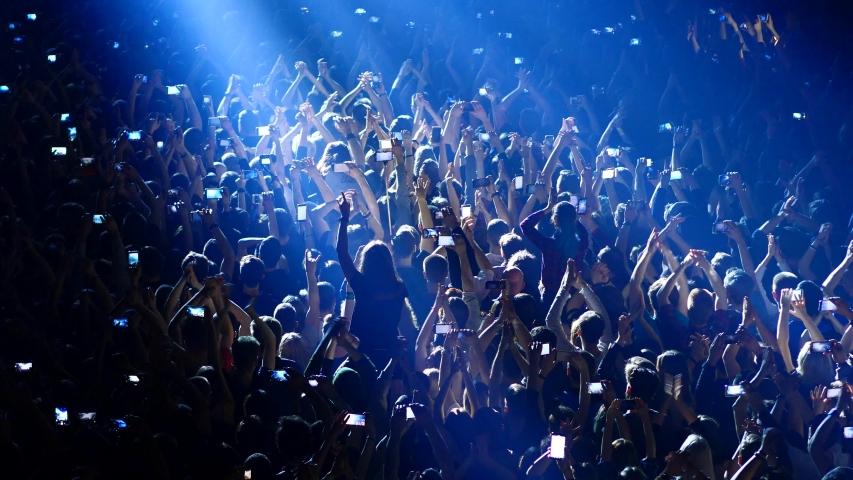 Joyful crowd enjoys listening famous group rock concert | Shutterstock HD Video #1032372821