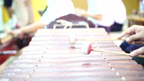 Asian hands playing of xylophone thai traditional music instrument   xylophone is a musical instrument in percussion family that consists of  wooden bars, wooden sound struck by mallets