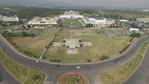 Islamabad, Pakistan - March, 2019: Drone View of D Chowk Islamabad, Long Shot of President House, Parliament and Senate of Pakistan, Aerial View Day Light Shot of Green Capital City of Pakistan