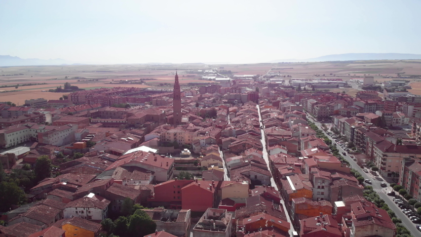 Aerial view of Santo Domingo de la Calzada, small Spanish village in Spain along Camino de Santiago or Way of Saint James. Urban landscape with homes seen from drone flying in sky | Shutterstock HD Video #1032518381