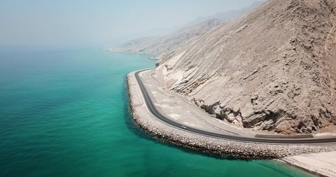 Coastal road and seaside in Musandam Governorate of Oman aerial footage