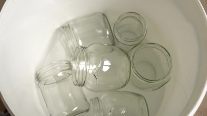Recycle Glass at Home. Domestic Recycling bin. Empty jars and bottles sorting. Zero waste lifestyle | Shutterstock HD Video #1032872381