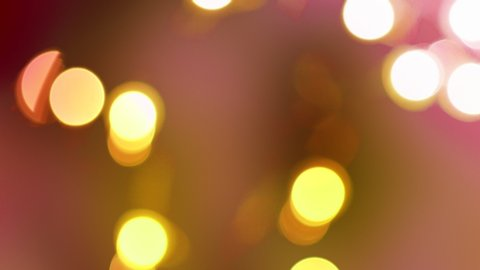 Rose Gold abstract blurred Christmas lights bokeh background in 4K