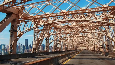 Driving on Queensboro Bridge on a sunny day connecting New York City midtown to Brooklyn