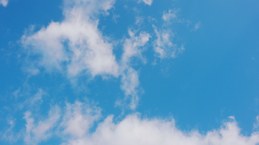White clouds floating in the blue sky. #1033189541