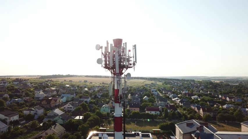Telecommunication tower of 4G and 5G cellular. Base Station or Base Transceiver Station. Wireless Communication Antenna Transmitter. Telecommunication tower with antennas against blue sky.   Shutterstock HD Video #1033542851