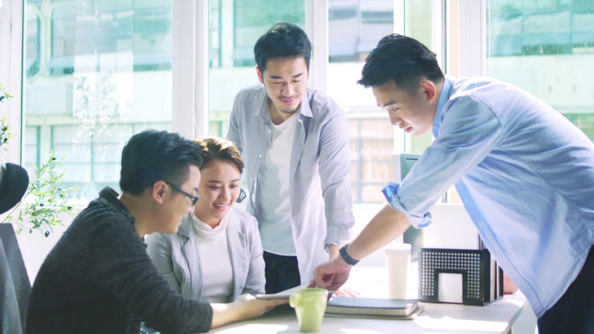 Group of four young asian business people men and woman meeting discussing in office | Shutterstock HD Video #1033672841
