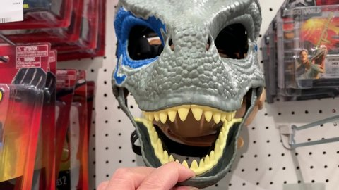 San Jose, California / United States - 05 30 2019: San Jose, California (USA) - May 9, 2019. A Velociraptor Blue mask made by Mattel from the popular movie Jurassic World.