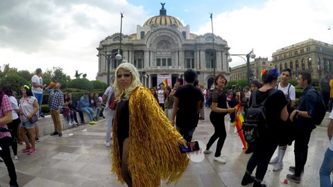 Mexico city, mexico-june 29, 2019: members of the lgbt community  celebrating and dancing in front of the palace of fine arts, thousands of  people celebrated the 41st anniversary of the pride march