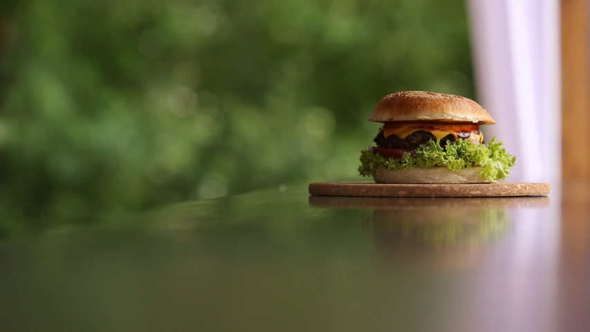 Appetizing burger burger on the table | Shutterstock HD Video #1033863401