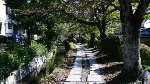 Kyoto, Japan: October 19, 2018: Philosopher's Path, a walking trail in Kyoto's Higashiyama district. The Philosopher's Path is named after Nishida Kitaro, a Japanese philosopher who took this path.