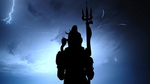Shiva, hinduism statue, thunderstorm timelapse