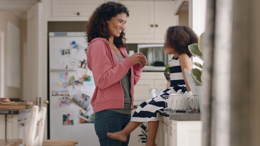 Mother applying band aid to little girls knee caring for her child at home happy kid enjoying motherly love | Shutterstock HD Video #1034157431