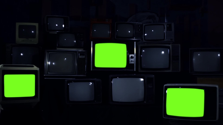 """Retro Televisions Turning On Green Screen. Blue Dark Tone. Zoom Out. You can replace green screen with the footage or picture you want with """"Keying"""" effect in AE (check out tutorials on Internet). 