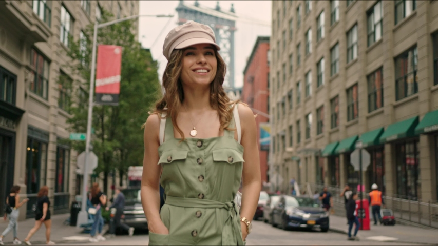 Pretty french lady walks around Manhattan. Moment from traveler's life. First time in New York. Famous views of big city. Enjoying the moment and feeling happy. | Shutterstock HD Video #1034429891