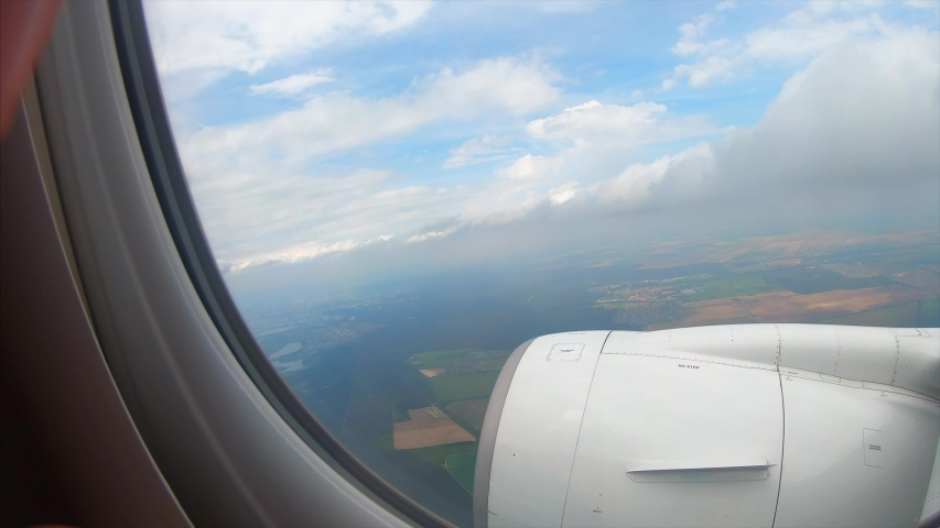 View from the window of a passenger airplane of a landscape #1034432171