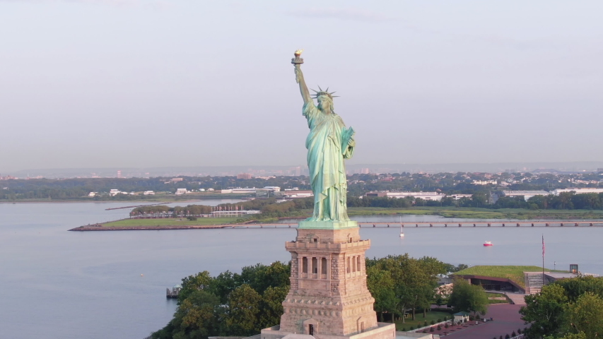 Slow cinematic aerial Staute of Liberty; cinematic; 4k; sunny morning. | Shutterstock HD Video #1034447711