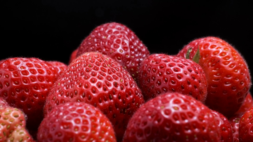 Strawberries on black background. Rotation 360 degrees, closeup. 4K - 50fps | Shutterstock HD Video #1034496251