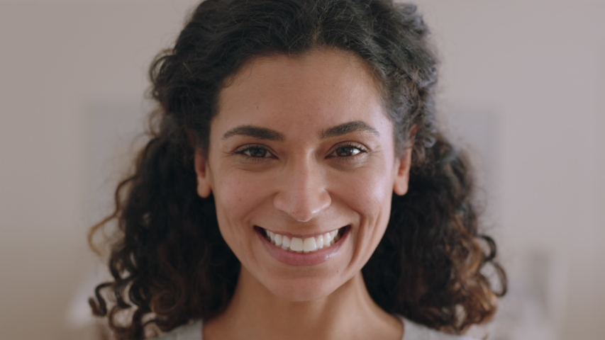 Portrait beautiful mixed race woman smiling 30's looking up at camera with happy emotion enjoying successful lifestyle | Shutterstock HD Video #1034551871