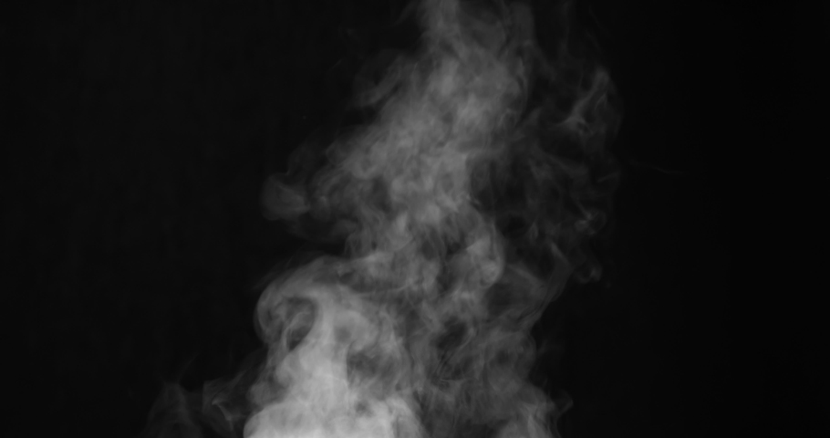 White Steam Ascends Over the Pan. White Steam rises from a large pot that is behind the scenes. Black background. Filmed at a speed of 120fps #1034566781
