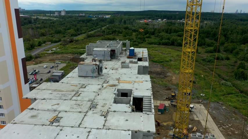 Aerial view big construction crane, close up. Construction crane on a building background, close up. | Shutterstock HD Video #1034569781