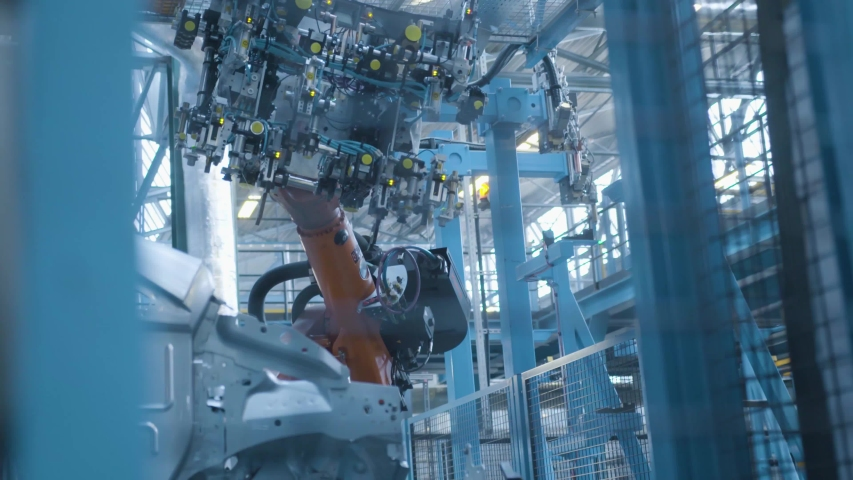 Car production industry. Automotive plant. Robots at the assembly line | Shutterstock HD Video #1034668901