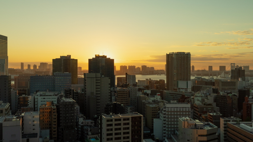 Time Lapse of the densely packs buildings of Tokyo Japan at sunrise | Shutterstock HD Video #1034689991