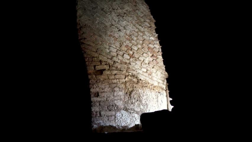Dark old medieval room with a window open, Klis fortress, Croatia #1034792591