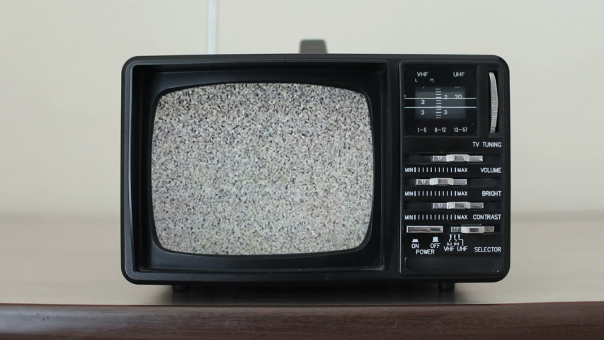 Static noise on a vintage TV set in a room | Shutterstock HD Video #1034801561