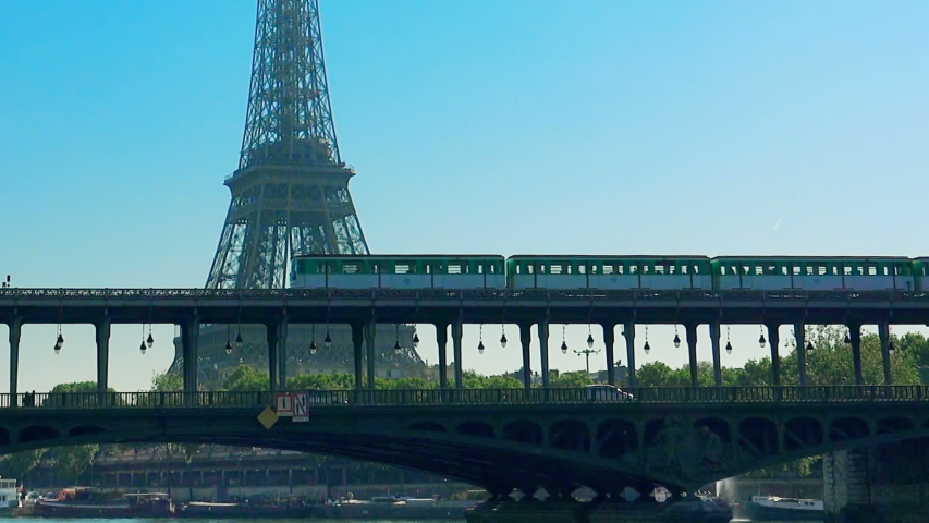 Metro train over Bir-Hakeim bridge and the Eiffel Tower - Paris - France | Shutterstock HD Video #1034912051