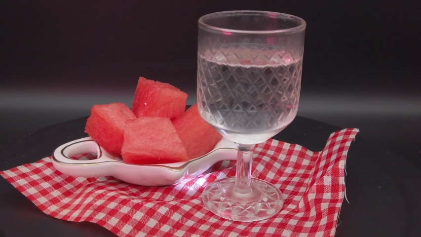A rotating arrangement on a dark background. Stack and pieces of watermelon. | Shutterstock HD Video #1035147401