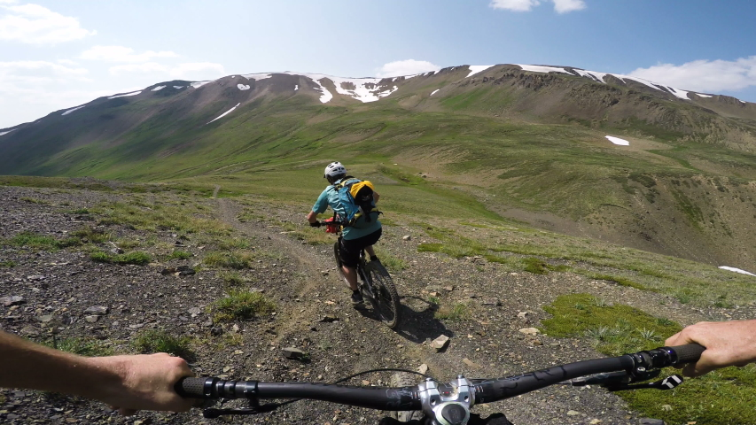 Mountain Bikers Point Of View Riding An Alpine Trail On A Sunny Day | Shutterstock HD Video #1035174041