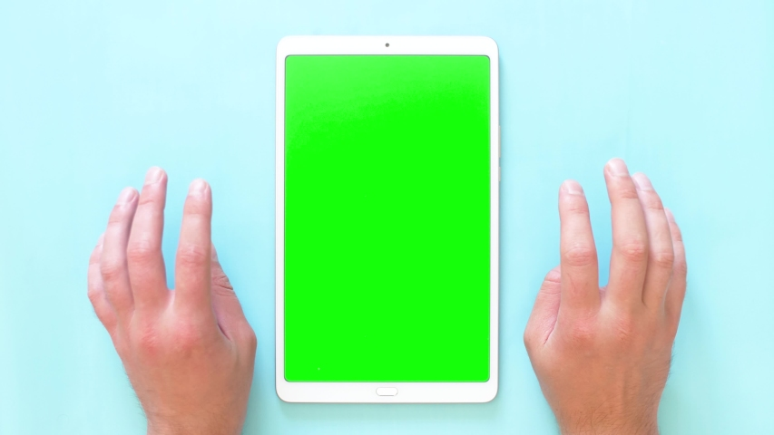 Men's hands knock on the surface with a tablet. Green screen footage. 4k top view. | Shutterstock HD Video #1035192191