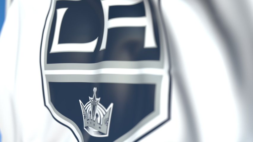 Waving flag with Los Angeles Kings NHL hockey team logo, close-up. Editorial loopable 3D animation | Shutterstock HD Video #1035229721
