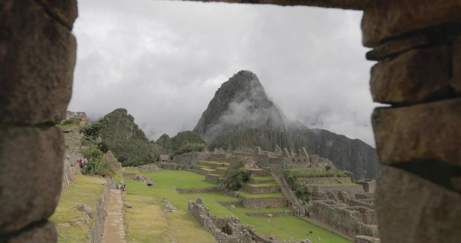 View of Machu Picchu through a window in the ruins