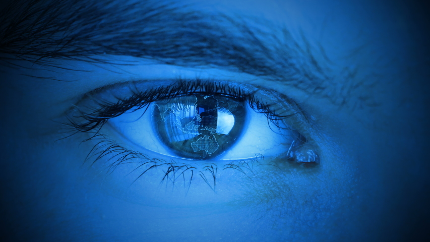 Close up to human eye with planet earth spinning. Control and protection of persons, control and security in the accesses technology. Stylized blue cold tint color.   Shutterstock HD Video #1035339791