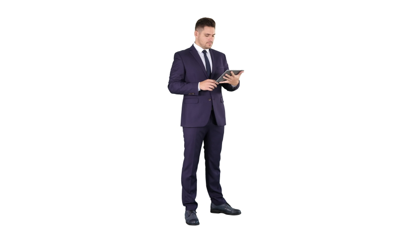 Expressive young businessman with tablet presenting something swiping on white background. | Shutterstock HD Video #1035419021