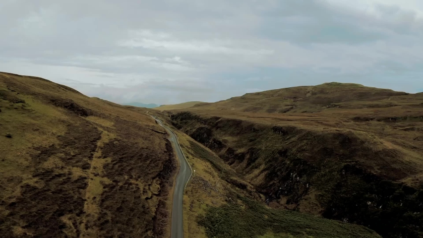 Scottish road in the mountains cloudy day high view | Shutterstock HD Video #1035428831