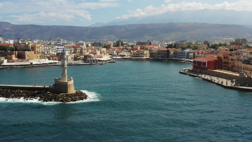 Aerial drone view video of iconic and picturesque Venetian old port of Chania with famous lighthouse and traditional character, Crete island, Greece. Architecture of the Venetian port in Chania. | Shutterstock HD Video #1035430511