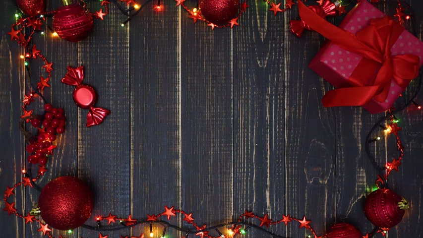 Top view flat lay video footage of beautiful holiday red and brown Christmas background with copy space in middle of frame. Real time 4k video footage. | Shutterstock HD Video #1035535271