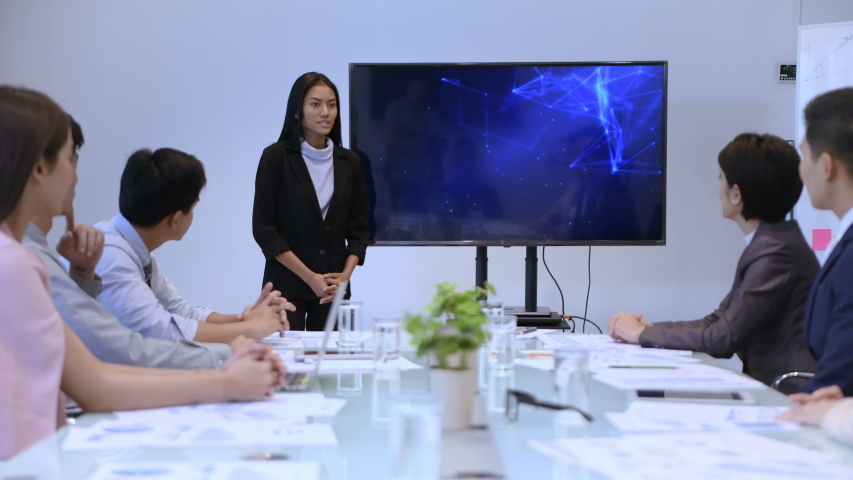 Business concept. Women are presenting work at the meeting. 4k Resolution. | Shutterstock HD Video #1035537521