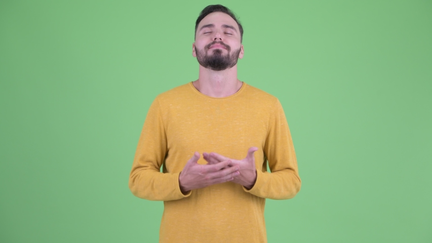 Happy young handsome bearded man relaxing with eyes closed | Shutterstock HD Video #1035607091